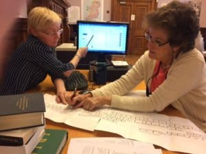 "Ann Gregg, a genealogy consultant, helps Patricia Smith-McCarthy track down a cousin at the Genealogy Advisory Service at the National Library of Ireland, Dublin. Gregg helped Smith-McCarthy, who grew up on Long Island, New York and now lives with her husband in South Carolina, secure a copy of her grandfather's brother's marriage license, phone numbers, and email addresses of living contemporaries in County Cork. Previously, her siblings were only able to glean anecdotal evidence after asking around at a pub near the farm, she says. ""It is very rewarding,"" says Gregg about her work. Sometimes Americans, who make up three-quarters of all those seeking their roots at the Genealogy Advisory Service, come fresh off a tour bus after being told of the office. ""They start making phone calls home to get whatever information they know is there,"" says Gregg, who's organization, www.ancestornetwork.ie, contracts with the library."